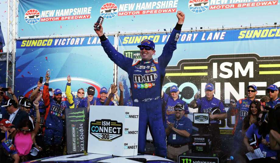Kyle Busch raises his arms after winning the NASCAR Cup Series 300 auto race at New Hampshire Motor Speedway in Loudon, N.H., Sunday, Sept. 24, 2017. (AP Photo/Charles Krupa) ORG XMIT: NHCK105 Photo: Charles Krupa / Copyright 2017 The Associated Press. All rights reserved.