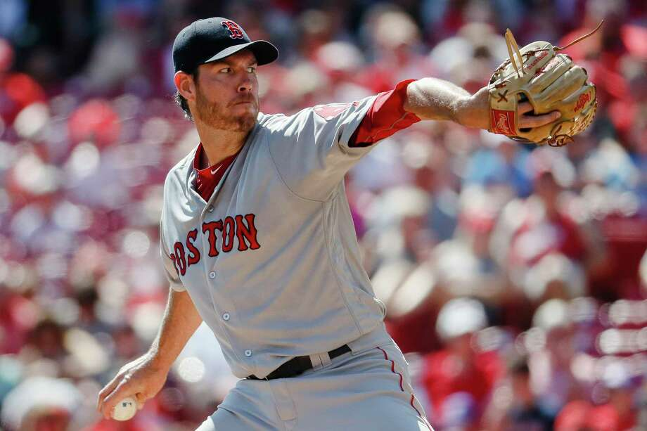 Boston Red Sox starting pitcher Doug Fister throws in the second inning of a baseball game against the Cincinnati Reds, Sunday, Sept. 24, 2017, in Cincinnati. (AP Photo/John Minchillo) ORG XMIT: OHJM104 Photo: John Minchillo / AP