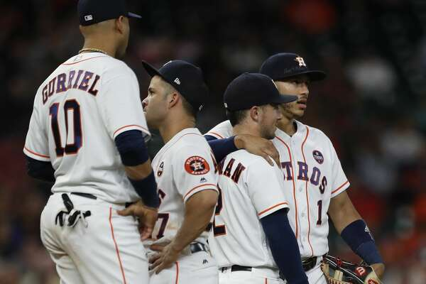 Houston Astros Carlos Correa (1) chats with Alex Bregman (2) as they wait for relief pitcher Chris Devenski to run out to the mound during the sixth inning of an MLB baseball game at Minute Maid Park, Sunday, Sept. 24, 2017, in Houston.  ( Karen Warren / Houston Chronicle )