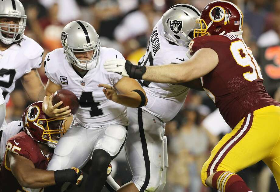 LANDOVER, MD - SEPTEMBER 24: Quarterback Derek Carr #4 of the Oakland Raiders is taken down by tight end Vernon Davis #85 of the Washington Redskins in the third quarter at FedExField on September 4, 2017 in Landover, Maryland.  (Photo by Patrick Smith/Getty Images) Photo: Patrick Smith, Getty Images