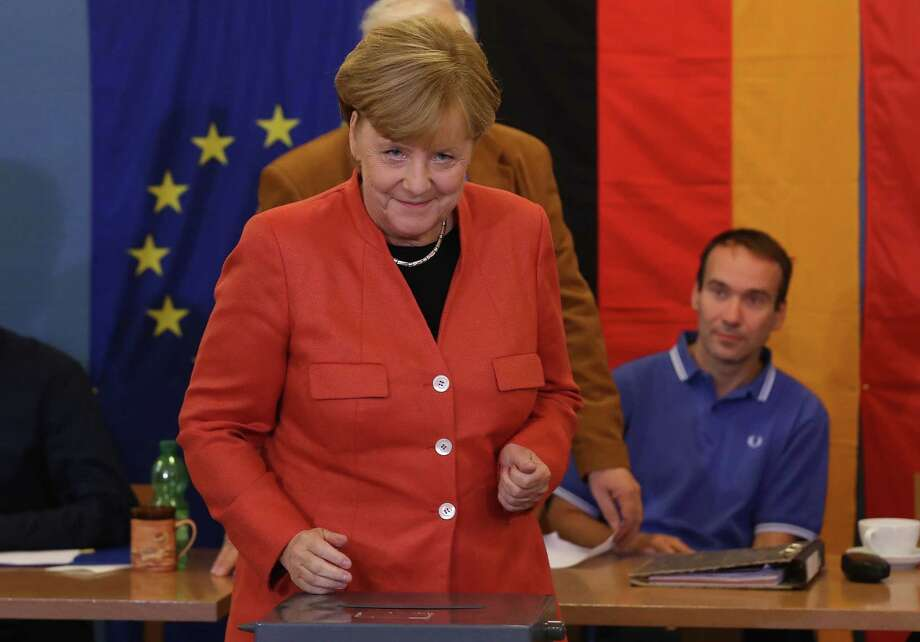 BERLIN, GERMANY - SEPTEMBER 24:  German Chancellor Angela Merkel departs after casting her ballot in German federal elections on September 24, 2017 in Berlin, Germany. Merkel is seeking a fourth term and has a strong lead going into the elections over her rivals. However a significant number of voters were undecided in days prior to the election and the full outcome remains difficult to predict.  (Photo by Sean Gallup/Getty Images) ORG XMIT: 775047118 Photo: Sean Gallup / 2017 Getty Images