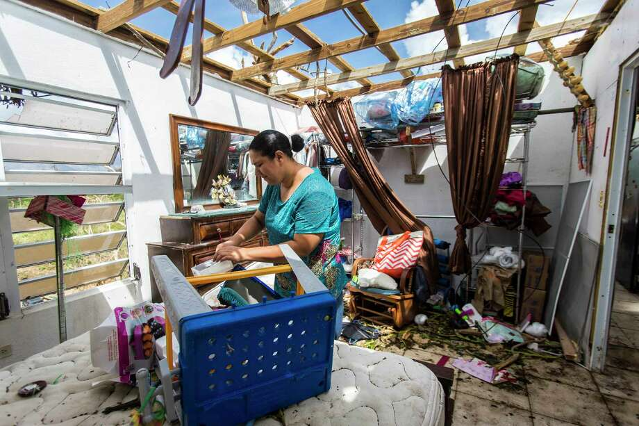 Meryanne Aldea lost everything at her house in Juncos when the winds of Hurricane Maria ripped away the roof. The Puerto Rico town remains largely isolated from the rest of the island - and the world. Photo: Photo For The Washington Post By Dennis M. Rivera Pichardo / For The Washington Post