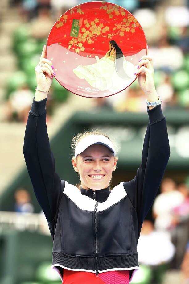 TOKYO, JAPAN - SEPTEMBER 24: Caroline Wozniacki of Denmark celebrates beating Anastasia Pavlyuchenkova of Russia during the women's singles final match during day seven of the Toray Pan Pacific Open Tennis At Ariake Coliseum on September 24, 2017 in Tokyo, Japan. (Photo by Koji Watanabe/Getty Images) ORG XMIT: 775025017 Photo: Koji Watanabe / 2017 Getty Images