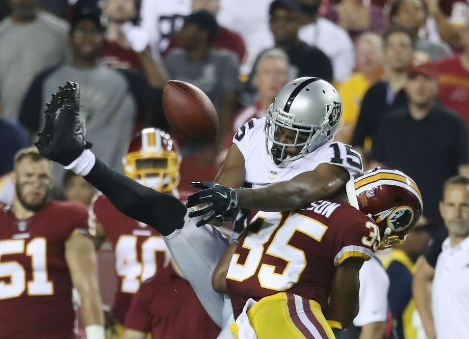 LANDOVER, MD - SEPTEMBER 24: Wide receiver Michael Crabtree #15 of the Oakland Raiders tries to make a catch against strong safety Montae Nicholson #35 of the Washington Redskins in the four quarter at FedExField on September 24, 2017 in Landover, Maryland.  (Photo by Rob Carr/Getty Images) Photo: Rob Carr, Getty Images
