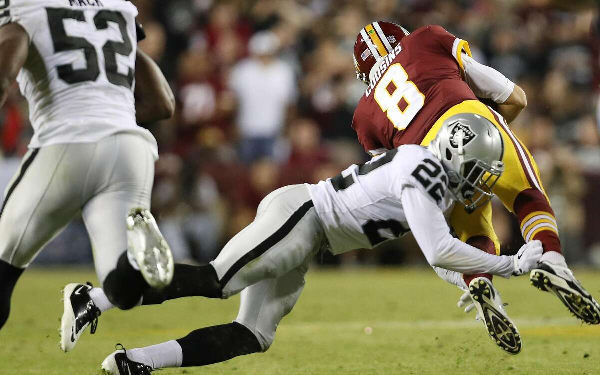 Quarterback Kirk Cousins #8 of the Washington Redskins is sacked by cornerback Gareon Conley #22 of the Oakland Raiders in the third quarter against the Oakland Raiders at FedExField on September 4, 2017 in Landover, Maryland. The Raiders