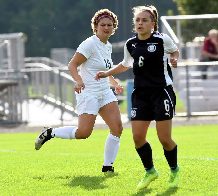 Schalmont's Davia Rossi (10) in action with Holy Names Academy's Ava Panto (6) during a Section II Class B girls' high school soccer game in Rotterdam, N.Y., Thursday, Sept. 21, 2017. (Hans Pennink / Special to the Times Union) ORG XMIT: HP107 Photo: Hans Pennink / Hans Pennink