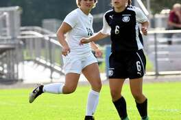 Schalmont's Davia Rossi (10) in action with Holy Names Academy's Ava Panto (6) during a Section II Class B girls' high school soccer game in Rotterdam, N.Y., Thursday, Sept. 21, 2017. (Hans Pennink / Special to the Times Union) ORG XMIT: HP107
