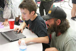 Lincoln Junior High 6th grader Raye Jones and his dad T.J. Jones enjoyed working together on a technology station at the 2nd Annual LJH Science & Technology Night on Sept. 21.