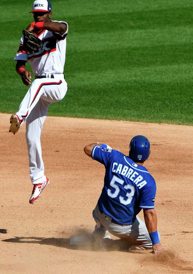 Chicago White Sox shortstop Tim Anderson, left, catches a throw as Kansas City Royals' Melky Cabrera (53) slides safely into second base during the sixth inning of a baseball game in Chicago, Sunday, Sept. 24, 2017. (AP Photo/Matt Marton) ORG XMIT: CXS114 Photo: Matt Marton / FR170980 AP