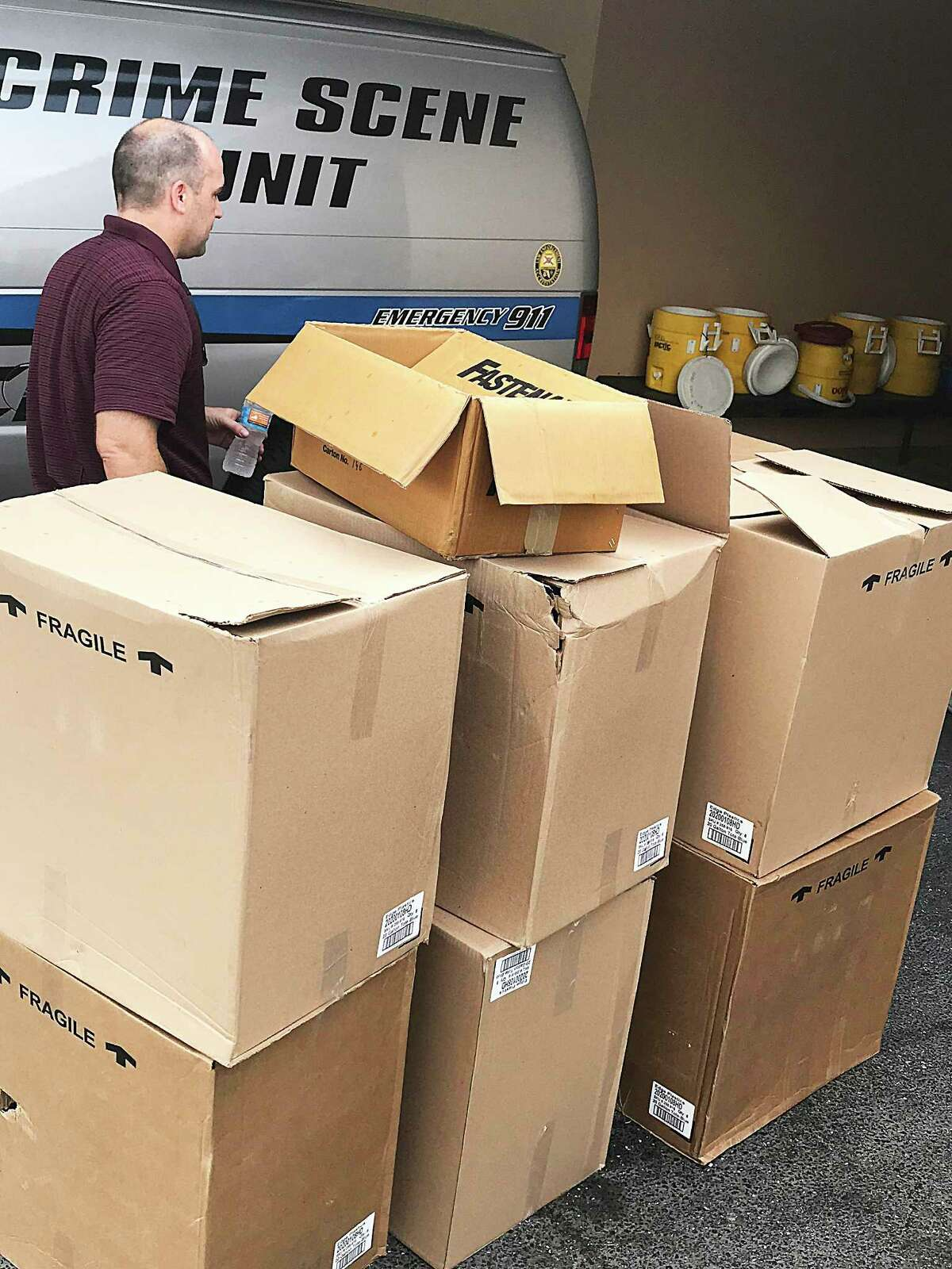Boxes of supplies lined one of the garages by the police station in Venice where Dayton leaders unloaded their donations.