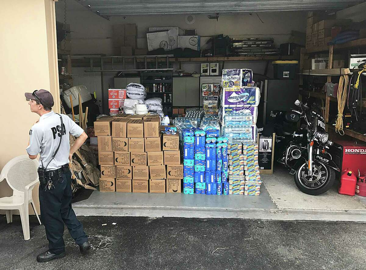 Above is a garage where Texas donations were stacked and received by the police force in Venice, Florida.