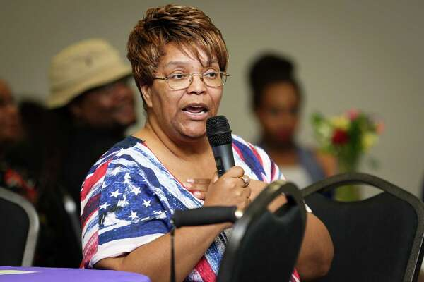 """Carolyn Easley Allen, 64, daughter of Lewis Tom """"LT"""" Easley, speaks during the 70th Annual Easley Family Reunion on Sunday at the Lone Star Community Center in Montgomery."""