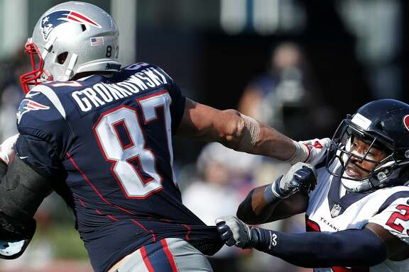 New England Patriots tight end Rob Gronkowski (87) breaks away from Houston Texans free safety Andre Hal (29) during the third quarter of an NFL football game at Gillette Stadium on Sunday, Sept. 24, 2017, in Foxbourough, Mass. ( Brett Coomer / Houston Chronicle )