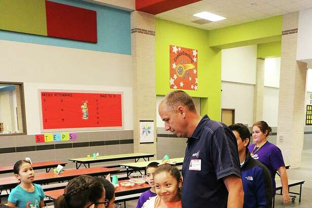 Family Pastor Howie Howeth from First Baptist Church receives some thank you cards and hugs from Richter Elementary.