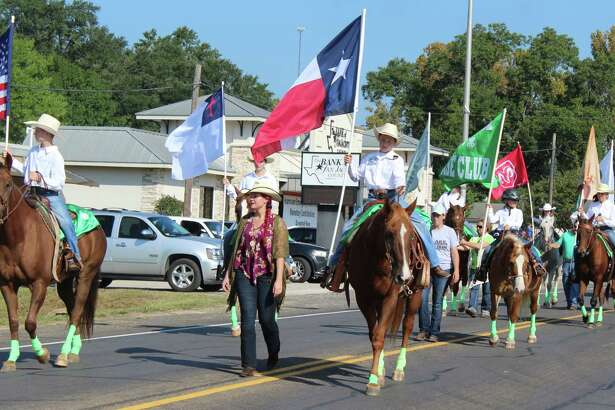 Trail riders lead the San Jacinto County Fair and Rodeo parade on Sept. 23.