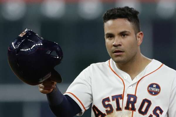 Houston Astros Jose Altuve (27) walks back from second base after Evan Gattis struck out during the seventh inning of an MLB baseball game at Minute Maid Park, Sunday, Sept. 24, 2017, in Houston.  ( Karen Warren / Houston Chronicle )