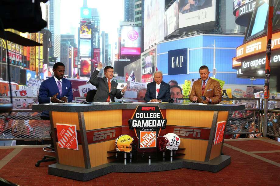 "Analysts Lee Corso, Kirk Herbstreit and Chris Fowler on Sept. 23, 2017 during ESPN's College GameDay show at Times Square in New York City. ESPN owner Walt Disney is in negotations for a new ESPN carriage agreement on Altice USA's Optimum cable TV service, with Altice USA stating in September the companies are ""hundreds of millions of dollars"" on deal terms. (Photo by Mike Stobe/Getty Images) Photo: Mike Stobe / Getty Images / 2017 Getty Images"