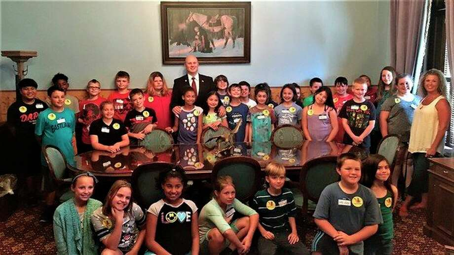 Eastlawn Elementary School fourth graders, taught by teacher Kelly Kraatz, far right, visited state Rep. Gary Glenn's office at the state Capitol in Lansing this summer. Glenn, back row center, visited the same class in Midland last winter to read Dr. Seuss's 'Thidwick the Big-Hearted Moose' during March is Reading Month. (Photo provided)