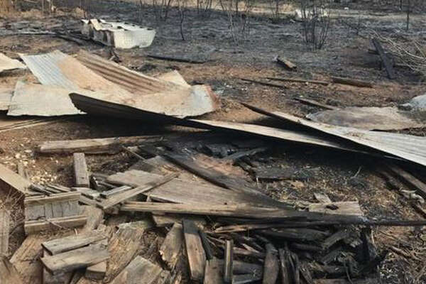 La Salle firefighters extinguished the blaze that ultimately claimed two acres of brush country in Cotulla, Texas.