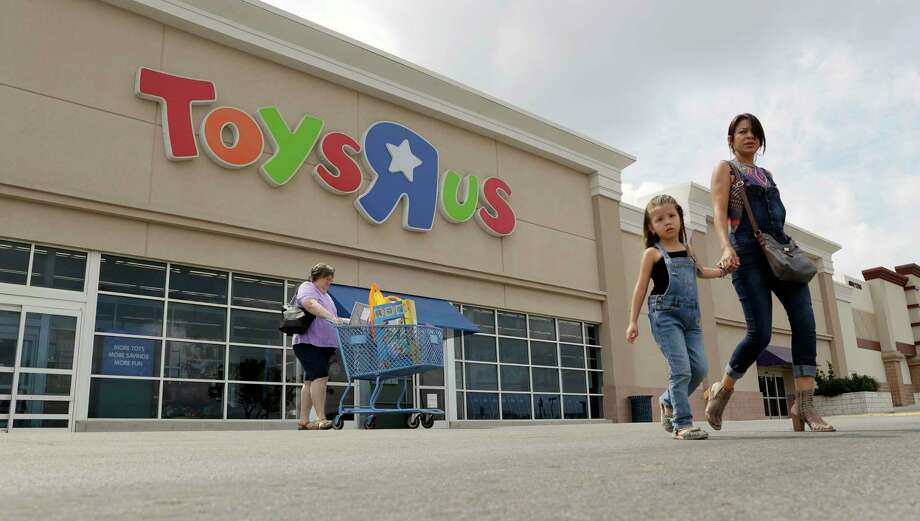 Shoppers leave a Toys R Us store, Tuesday, Sept. 19, 2017, in San Antonio. Toys R Us has filed for Chapter 11 bankruptcy protection while continuing with normal business operations. (AP Photo/Eric Gay) Photo: Eric Gay, STF / Copyright 2017 The Associated Press. All rights reserved.