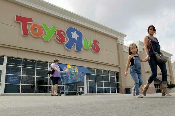 Shoppers leave a Toys R Us store, Tuesday, Sept. 19, 2017, in San Antonio. Toys R Us has filed for Chapter 11 bankruptcy protection while continuing with normal business operations. (AP Photo/Eric Gay)