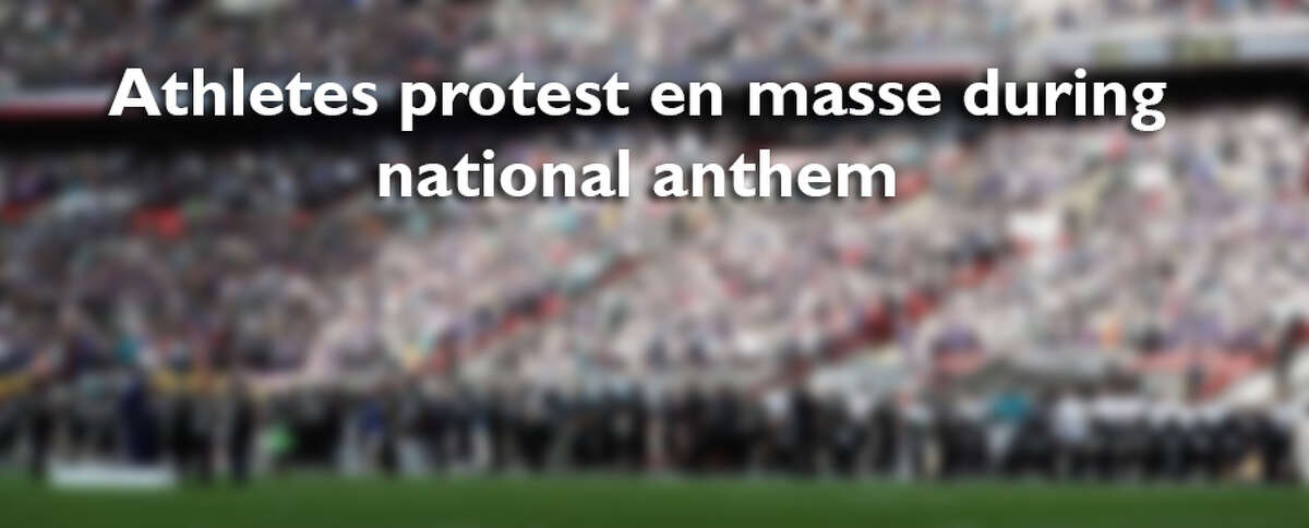 Swipe through to see photos of athletes protesting during the national anthem.