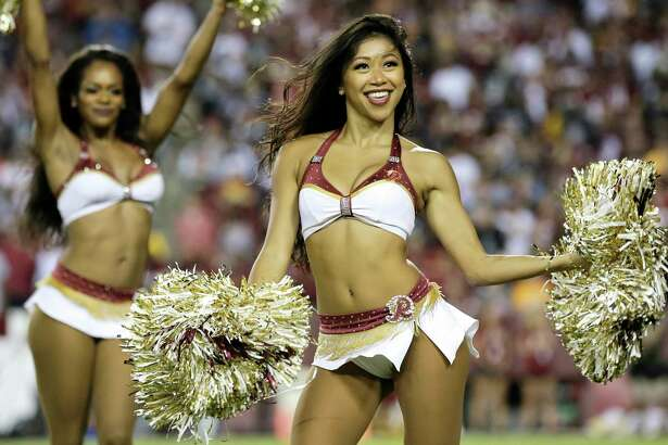 Washington Redskins cheerleaders perform during an NFL football game between the Oakland Raiders and Washington Redskins, Sunday, Sept. 24, 2017, in Landover, Md. (AP Photo/Mark Tenally)