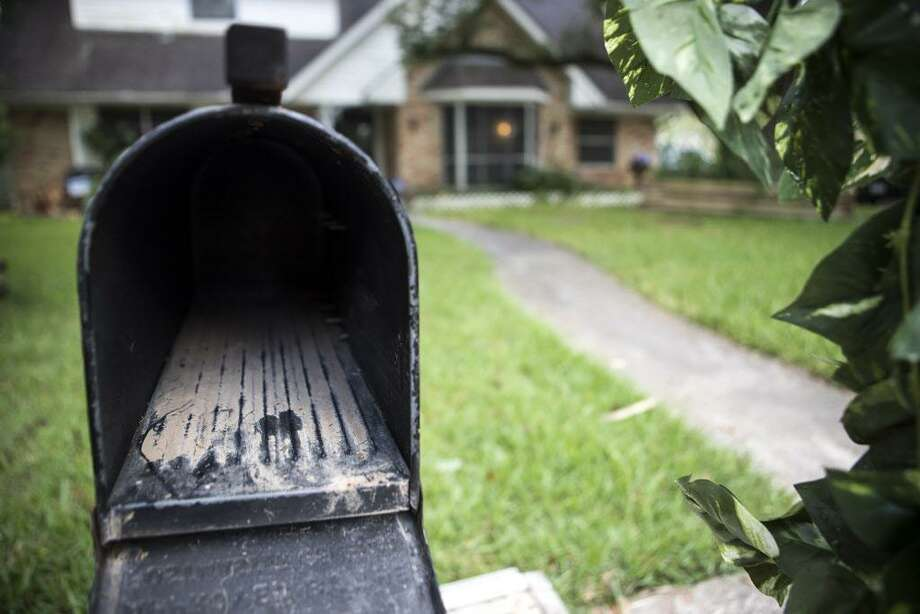 Dried mud is seen inside the mailbox at the home of Eugene Cox in the Arbor Oaks neighborhood on Wednesday, Sept. 20, 2017, after it was flooded in the aftermath of Hurricane Harvey in Houston. The neighborhood used to be home to 160 houses and is now down to 13, after most of the homeowners, having flooded repeatedly, sold to the county Flood Control District. ( Brett Coomer / Houston Chronicle ) Photo: Brett Coomer / Houston Chronicle / © 2017 Houston Chronicle