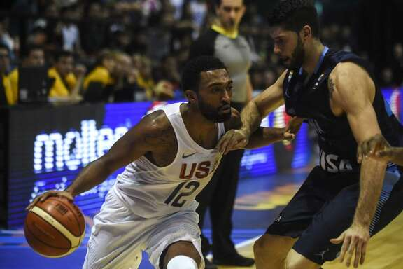 USA's small forward Darrun Hilliard II (L) drives the ball marked by Argentina's small forward Patricio Garino during their 2017 FIBA Americas Championship final match in Cordoba, Argentina, on Sept. 3, 2017.