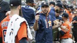 Justin Verlander greets Dallas Keuchel on Sept. 4.