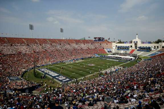 Fans watch in this general view of LA Memorial Coliseum during the second half of a game between the Los Angeles Rams and the Washington Redskins on Sept. 17, 2017, in Los Angeles.