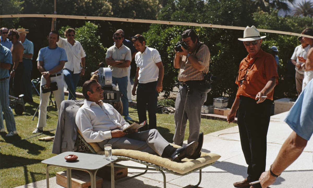 1) Sean Connery kicking back while filming