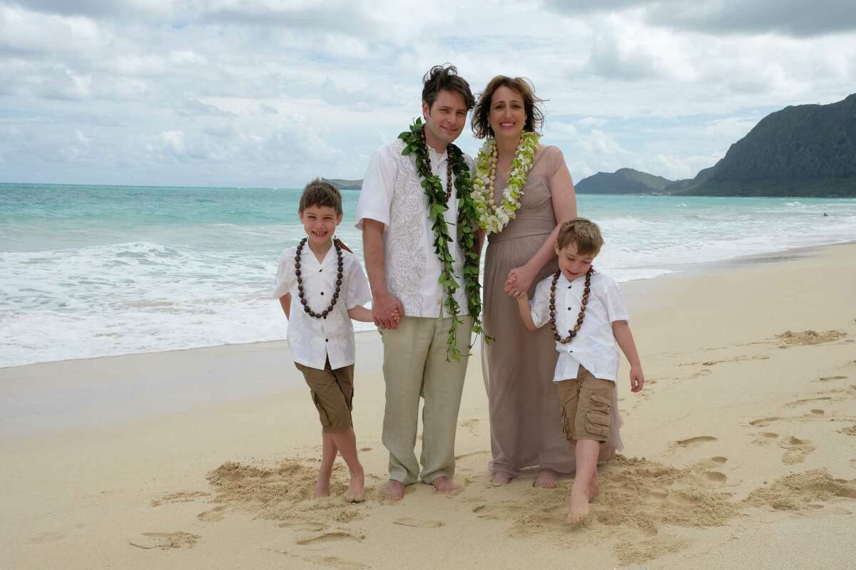 Laura Greco with her husband Tillman Nechtman, with their sons Rhys and Fletcher in Hawaii in February 2017. The couple renewed their wedding vows there.