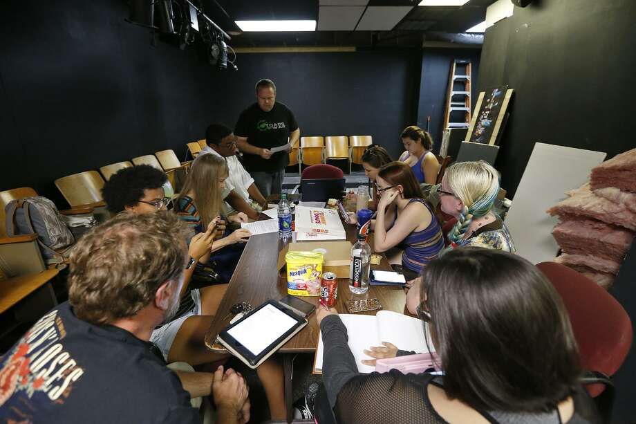 "The cast of ""Retired,"" a superhero noir serial, meet in the new Little Overtime space for a script read-through. Photo: Edward A. Ornelas /San Antonio Express-News / © 2017 San Antonio Express-News"