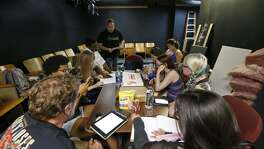 "The cast of ""Retired,"" a superhero noir serial, meet in the new Little Overtime space for a script read-through."