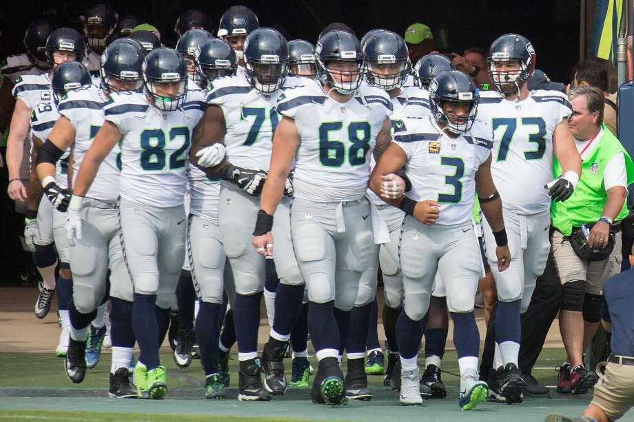 NASHVILLE, TN - SEPTEMBER 24:  The Seattle Seahawks leave the tunnel and enter the field arm-in-arm prior to a game against the Tennessee Titans at Nissan Stadium on September 24, 2017 in Nashville, Tennessee.  (Photo by Frederick Breedon/Getty Images) Photo: Frederick Breedon/Getty Images