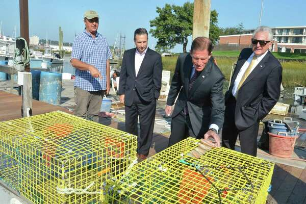 Norm Bloom, owner of Norm Bloom and Son, shows some lobster traps on one the company's lobster boats to U.S. Senator Richard Blumenthal, State Senator Bob Duff and Norwalk Mayor Harry Rilling during a tour of Copps Island Oysters on National Lobster Day Monday September 25, 2017 in Norwalk Conn.
