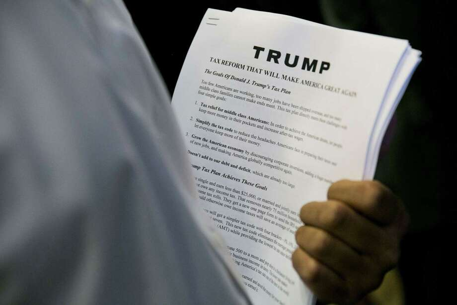 Media handouts describing the tax plan of Republican presidential hopeful Donald Trump's tax plan are viewed during a press conference at Trump Tower in New York on September 28, 2015. AFP PHOTO/DOMINICK REUTERDOMINICK REUTER/AFP/Getty Images ORG XMIT: 581573999 ORG XMIT: MER2017092513564845 Photo: DOMINICK REUTER / (c) Dominick Reuter reuterphoto.com