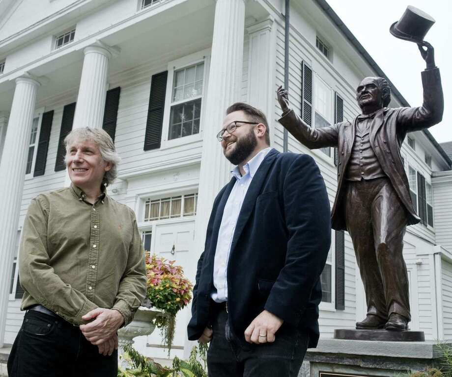 Sculptor Dave Gesualdi, of Bethel, and Connecticut filmmaker Corey Boutilier, of Westport, with the P.T. Barnum statue, in front of the Bethel Library last week. Photo: Scott Mullin / For Hearst Connecticut Media / The News-Times Freelance