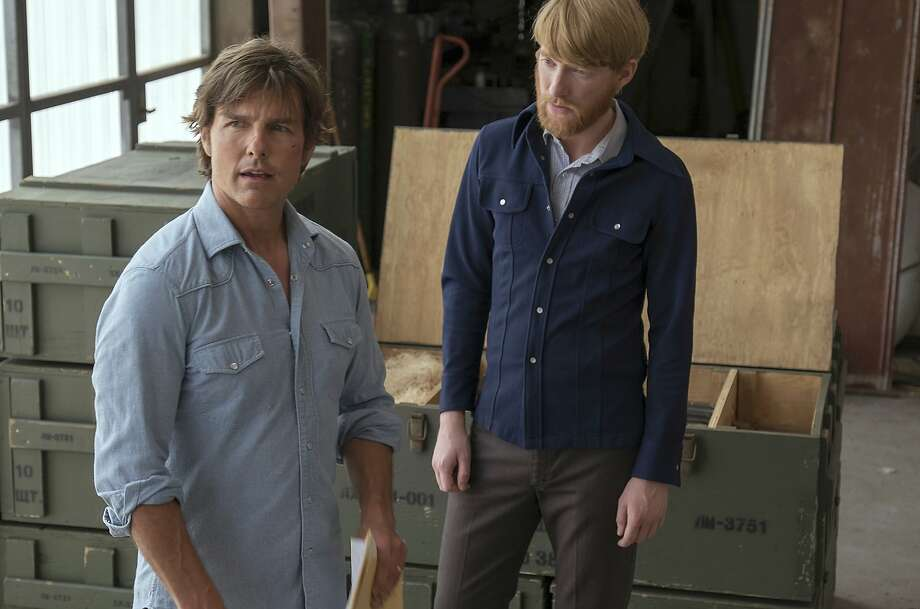 "Tom Cruise (left) and Domhnall Gleeson in ""American Made,"" which is worth enjoying, if pretty hard to make sense of. Photo: David James, Associated Press"