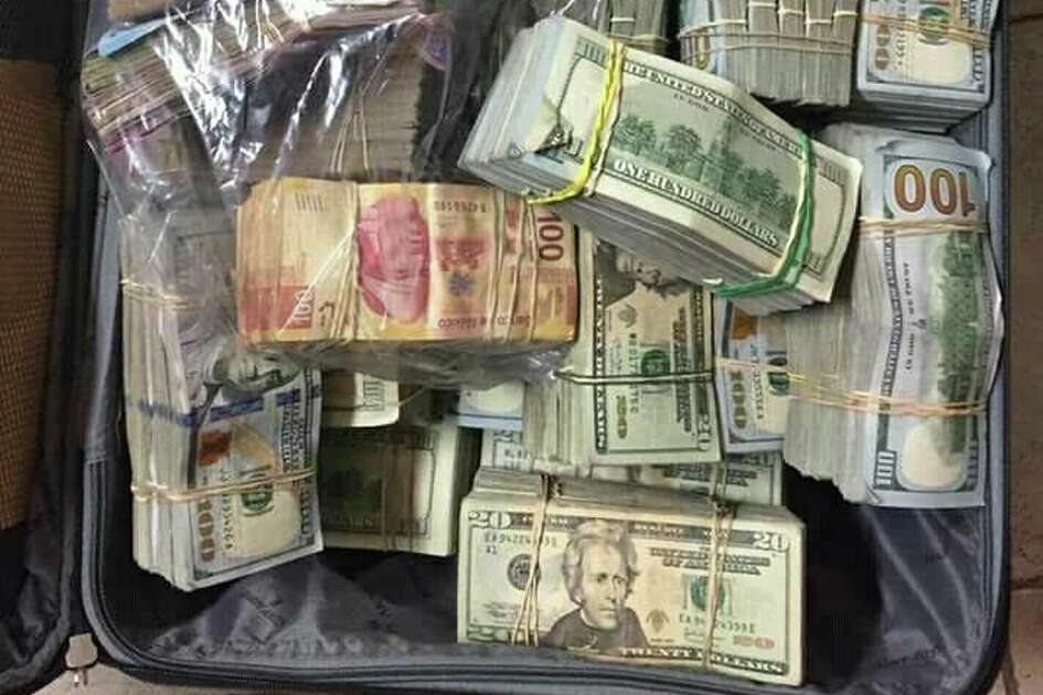 Authorities said they also found $2,344,980 and 1,026,410 pesos.