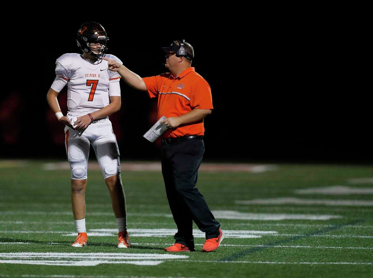 St. Pius X's quarterback Grant Gunnell (7) talks with head coach Stephen Hill during the first half of a high school football game between St. Pius X and St. Thomas High Schools at St. Thomas, Friday,Nov. 4, 2016 in Houston. ( Karen Warren / Houston Chronicle )
