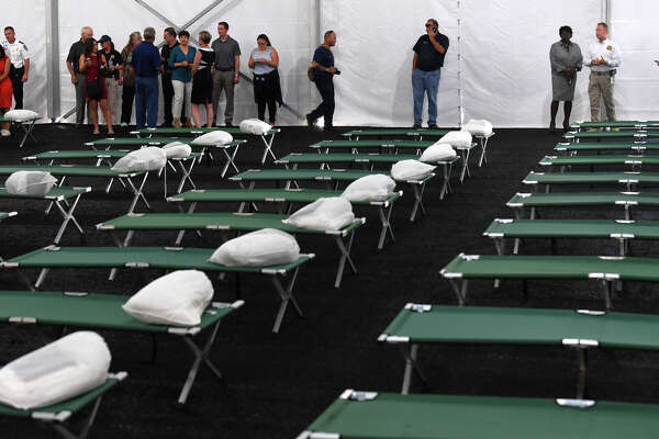 Orange County officials and media tour the newly erected tents set up in Orange to house storm displaced residents. The doors opened to the community later that day. The state-funded facility can accommodate 250 people and can be expanded to house more if needed.  Photo taken Monday, September 25, 2017 Guiseppe Barranco/The Enterprise