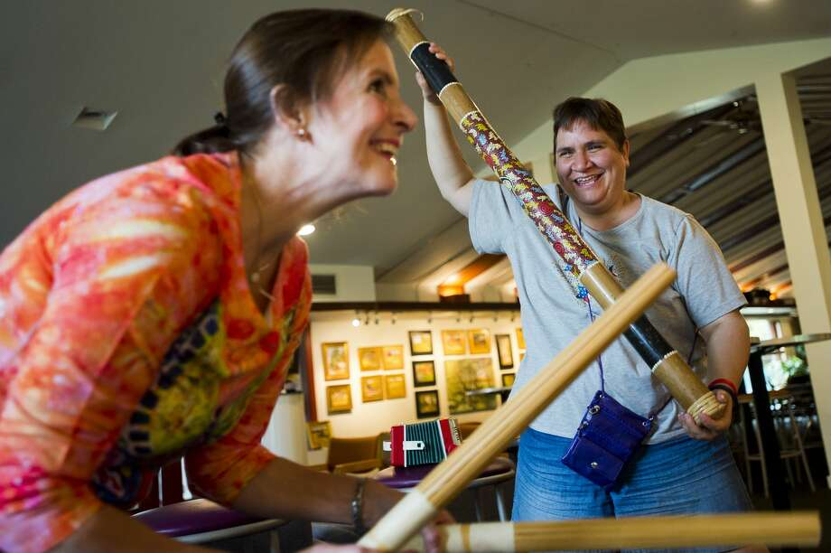 "Heather Naessens of Midland, right, dances and plays a rain stick as ""Shiny"" from the Moana soundtrack plays from a CD player during a music jam session led by Barbara Jacques, a volunteer with Creative 360, left, on Monday, Sept. 25, 2017. The jam session is held weekly and is designed to bring individuals together to play music and develop social skills in a structured setting. (Katy Kildee/kkildee@mdn.net) Photo: (Katy Kildee/kkildee@mdn.net)"