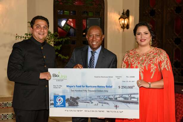 Indo-American community representatives Amit and Arpita Bhandari present a check of $250,000 to Houston Mayor Sylvester Turner (center) toward the Mayor's Fund for Hurricane Harvey Relief. In total, the Indo-American community has made a contribution of $1.5 million toward Hurricane Harvey relief.
