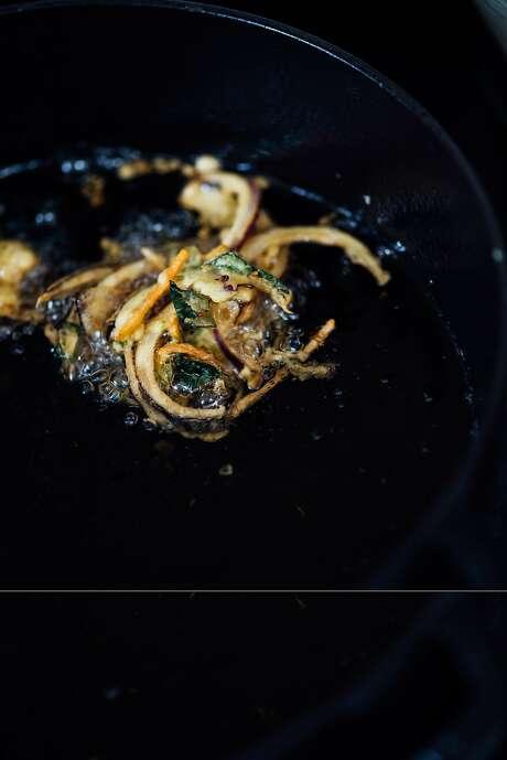 Frying pakoras. Photo: Nik Sharma