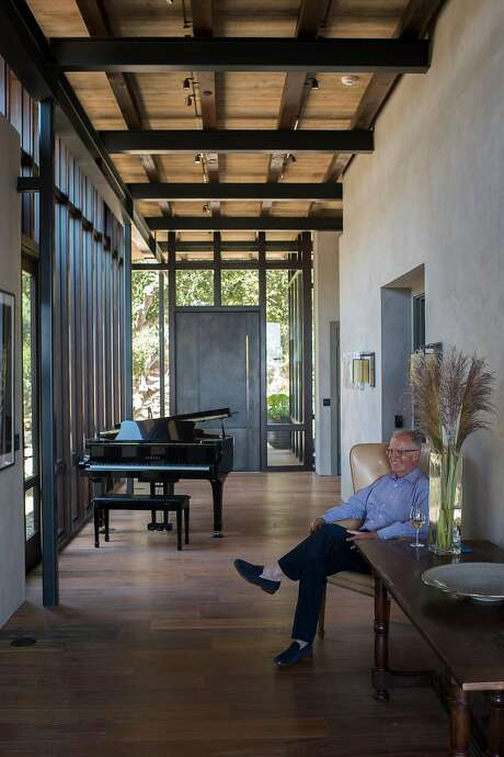 Fred Brown faces the floor-to-ceiling windows in the entry and living area of his Carmel home. Photo: Nic Coury, Special To The Chronicle