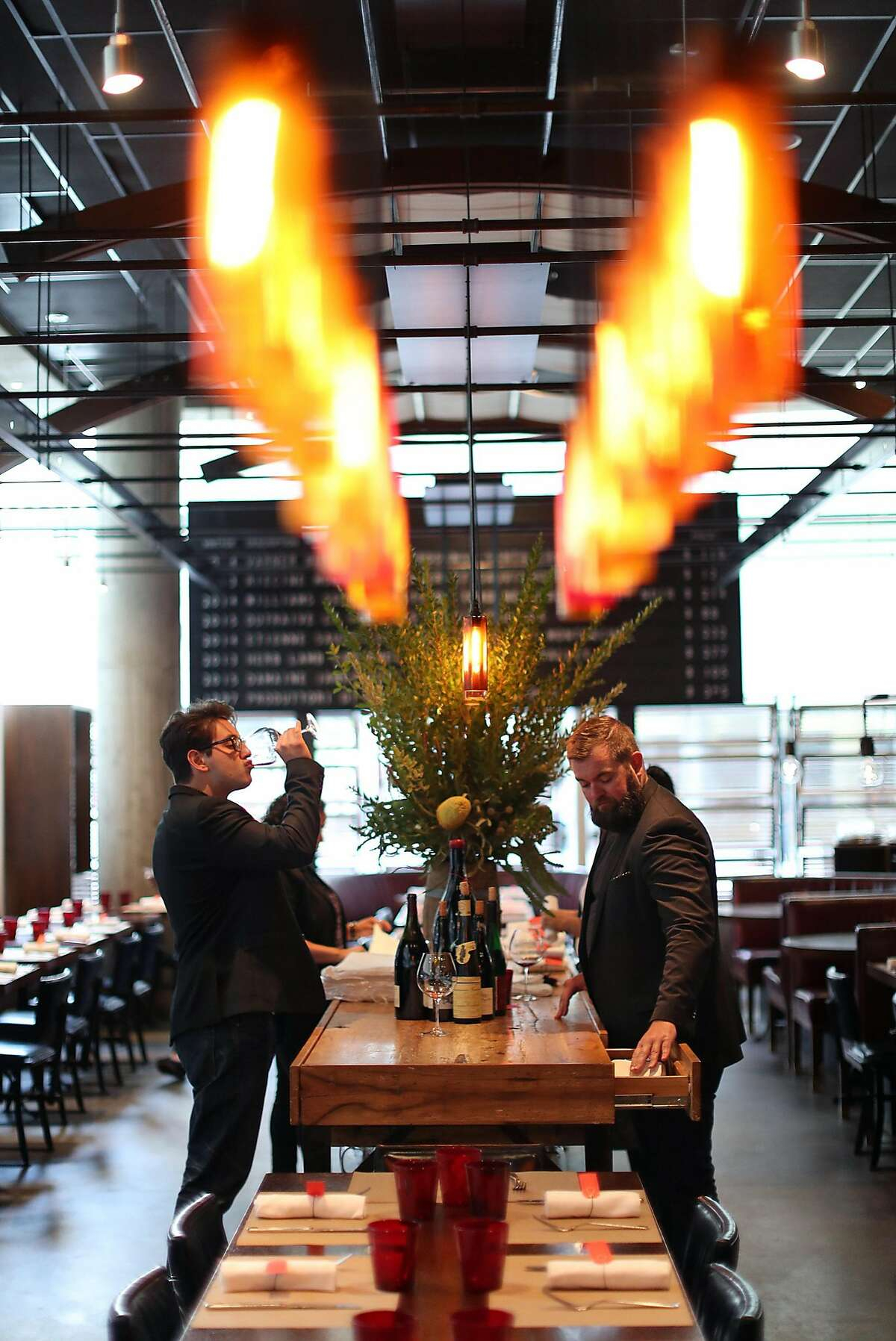 Sommelier Jeremy Shanker (left) and wine director David Castleberry choose wines to pair with dinner at RN74 in San Francisco, Calif., on Monday, September 18, 2017. The famed restaurant will serve its final meal on October 7th to make way for Ayesha Curry's new restaurant, International Smoke.