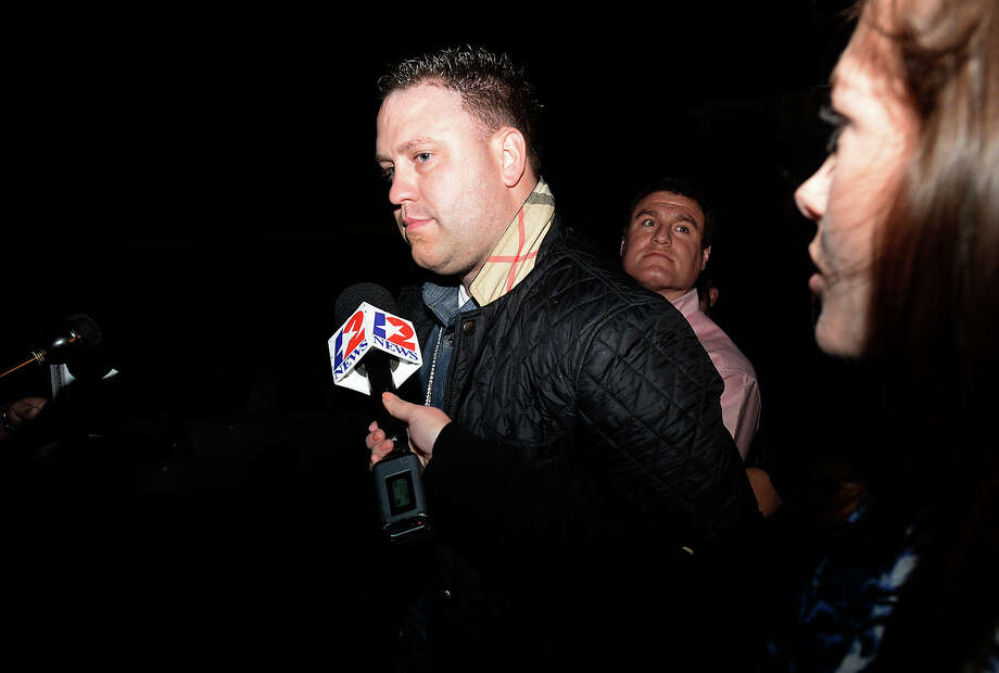 Adam Fuller is taken into custody after being arrested for a parole violation Tuesday. Fuller has been called a person of interest in the January 6 murder of his roommate in Beaumont's west end.  Photo taken Tuesday, January 20, 2015 Kim Brent/The Enterprise Photo: Kim Brent / Beaumont Enterprise