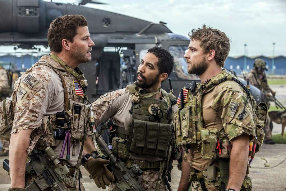 """This image released by CBS shows David Boreanaz, from left, Neil Brown Jr. and Max Thieriot in a scene from """"SEAL Team,"""" premiering Sept. 27, on CBS. (Skip Bolen/CBS via AP) Photo: Skip Bolen, HONS / é2017 CBS Broadcasting, Inc. All Rights Reserved"""